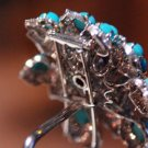 Brooch in its socle: white gold, turquoises